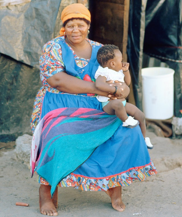 A South African woman sits with her child in Crossroads township.Peter Turnley/Corbis/VCG via Getty Images